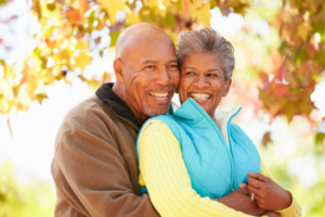 Health Savings Account African American couple hugging Over 65